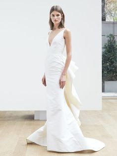 Oscar de la Renta Spring 2018 sleeveless trumpet gown with a deep V-neck and back bow detail