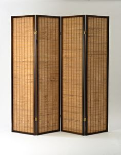 The beautiful Kobe room divider screen made with flat slat bamboo and dark timber surround available from #Futons247