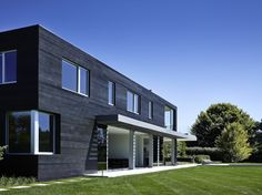black stained cedar siding, white windows, overhang, contemporary [Stelle Lomont Rouhani Architects Orchard House]
