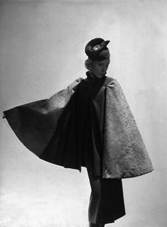 1937 -- 1937  Model is wearing a shaved buffalo and wool cape, a wool dress with a high drawstring neckline, and quilted jersey toque, all by Alix Grés.   Image by © Condé Nast Archive/CORBIS