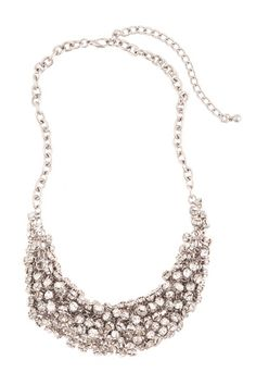 Clare Crystal Bib Necklace:   Clasping on a bib necklace is a surefire way to make a statement, and Clare's shape and glittering crystal baubles ensure that she will not renege on her duty!