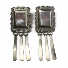 Now available on Bejeweled Emporium: Large Navajo Moth... Check it out here! http://www.bejeweledemporium.com/products/large-navajo-mother-of-pearl-dangle-earrings-vintage-sterling?utm_campaign=social_autopilot&utm_source=pin&utm_medium=pin