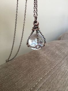 * this listing is for ONE necklace* please note that size of Quartz varies from 13mm- 18mm. A stunning clear quartz crystal ball encased in copper chain. Slips easily over the head on 32 chain Handmade in NY