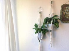 The Macrame Plant Hanger is made with high quality, 100% cotton rope. This piece is white in color with beautiful natural, green twine and a silver ring as accents. Every item is handmade with love and care. Each piece will vary slightly from the images shown above. Please allow 3-5 business