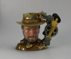 Royal Doulton Intermediate prototype Character Jug Clint Eastwood, designed in 2005 for The Celebrity Film Star Collection but never put into production Celebrity Film, Royal Crown Derby, Clint Eastwood, Beatrix Potter, Royal Doulton, Royal Albert, Art For Sale, Pet Birds, The Collector