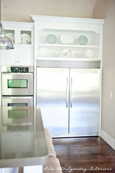 dream refrigerator + beautiful shelves above (Sita Montgomery Interiors via House of Turquoise)