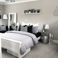 Luxury grey bedroom inspiration, grey and white modern bedroom with picture shelf styling and bedside tables, a reading corner and pillar candlesticks. White Bedroom Design, White Bedroom Decor, Room Ideas Bedroom, Home Decor Bedroom, Bedroom Chair, Bedroom Designs, Black White And Grey Bedroom, Black And Grey Bedroom, Bed Room