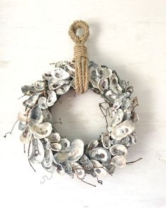 18 Oyster Shell Wreath, Oyster Wreath, Oyster Decor, Nautical Wreath, Beach Wreath Coastal Wreath, Beach Decor, Coastal Decor, Rope Wreath ______________________________________________________ This oyster shell wreath is great for those that dont care for bows and frilly stuff on their wreaths. Its classic and stylish for your coastal decor, because the neutral colors go with virtually everything! Made with a grapevine base, each oyster shell was hand picked by me on nearby Gulf beaches…