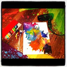 Using a hairdryer to melt crayons with a fork onto canvas - pretty!
