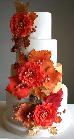 The brides colour scheme was orange and gold, and her wedding invitations featured autumn leaves, so we decided to feature this on the cake. The cascade featured orange and gold fantasy flowers, grape and oak leaves and hypericum berries all in...