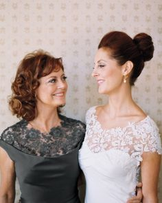 The Mother of the Bride and the Bride share a similar lace neckline on dresses. (Susan Sarandon and her daughter).