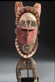 ABELAM CEREMONIAL CULT FIGURE  Hardwood, natural ochres   Middle Sepik River, Papua New Guinea   Height: 80 cm.