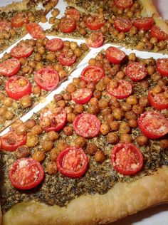 EASY CHICKPEA, CHERRY TOMATOES AND PESTO PIZZA This pizza is so delicious and easy to prepare, you'll want to eat it again and again. The pesto is rich and super tasty, the warm tomatoes bring a nice sweetness, and the chickpeas are deliciously crispy. Simply vegelicious