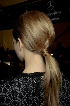 Add some extra volume to your low-slung ponytail by teasing the centre section loose and pinning in place.