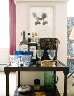 Bar Cart - Bar essentials and glassware on a square wooden table