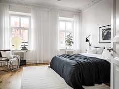 The bedroom in a stunning Swedish space in white - Stadshem.