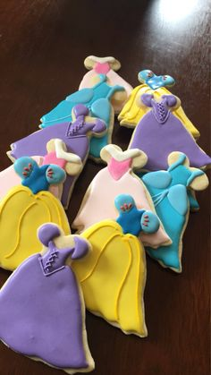 One dozen assorted princess dress cookies Individually wrapped and tied with matching ribbon Disney Princess Cookies, Disney Princess Birthday Party, Disney Cookies, Onesie Cookies, Cupcake Cookies, Sugar Cookies, Ballerina Cookies, Disney Desserts, Sugar Cookie Royal Icing