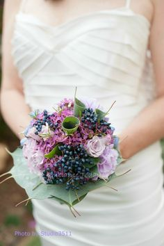 Ambiance Today - Hawaii Florists - Whimsical purple wedding bouquet with berries