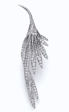 A STRIKING DIAMOND BIRD BROOCH, BY STERLE