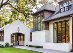 Some of our favorite homes lately have a common architectural feature--the porte cochere. Today we are talking about what it is and sharing some of our favorite examples on both historic homes and new builds. Porte Cochere, Architecture Design, Residential Architecture, White Brick Houses, White Stucco House, Stucco Houses, Villa, Architectural Features, House Goals