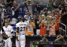 New sultan of swat: Stanton's year won't be forgotten  -  October 2, 2017:    Miami Marlins' Giancarlo Stanton (27) raises his bat after he struck out swinging for his last at bat during the ninth inning of a baseball game against the Atlanta Braves, Sunday, Oct. 1, 2017, in Miami. The Braves won 8-5. Stanton finished the season with 59 home runs. (AP Photo/Lynne Sladky)