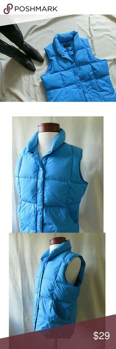 "LN Land's End Down Puffer Vest Electric Blue Med Awesome ""electric"" lagoon blue quilted puffer vest from Land's End! Snap closures down front, 2 large hip slip pockets, curved/ longer back hemline. Insulation is 70% goosedown, 30% feathers. Size Ladies Medium 10-12. In excellent condition, like new, no stains/ flaws/ odors. Packed carefully and shipped fast! Thanks so much, Jen  #986 Lands' End Jackets & Coats Vests"