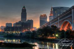 Skyline of Downtown Cleveland, Ohio and Veterans Memorial Bridge as taker from the Center Street swing bridge in the flats. Cleveland Skyline, Downtown Cleveland, Cleveland Rocks, Cleveland Wedding, Skyline Painting, Thing 1, Best Location, Lands End, Sun Moon