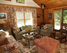Autumn is the best time of year to be in the country (it's almost a requirement to be present to admire the foliage). This Taghkanic log home is the perfect place to enjoy the changing of the leaves from any of the numerous windows, decks, balconies, and the cozy screened-in porch. The four-bedroom, two-bathroom home has an open kitchen, living room, and dining area, and most of the living spaces open to a deck or porch.