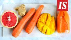 Kauniin värinen smoothie saa värinsä porkkanoista ja mangosta. Herkku maustetaan inkiväärillä.