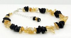 "Gemstones Chips Beaded Anklet 9"" Citrine Black Obsidian Ankle Chain Bracelet Handmade Jewellery By TaKuKai Made using flexible beading wire for extra strength Made using Tiger Tail flexible beading wire for extra strength Approx.. 4mm to 9mm Natural Gemstone Chips - Citrine and Black Obsidian Finished Sliver Plated Clasps and Rings approx 9"" - 9.25"" Long When Unfastened excluding adjustable chain (will be similar to the picture but due to nature of irregular shape chips - every piece is…"