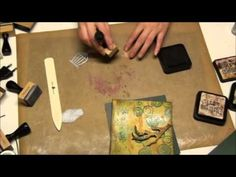 Tim Holtz: the video is in German but evidentally scrapbook terminology is all in English. If you know Tim Holtz products then you will fully get it.