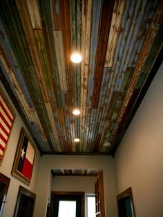 Check out our reclaimed wood by the linear foot. See bead board like this to create this unique ceiling.