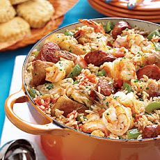 Easy Slow-Cooker Jambalaya Recipe Main Dishes with boneless chicken skinless thigh, smoked sausage, onion, green bell pepper, celery, tomatoes with juice, garlic, chicken broth, creole spice mix, dried thyme, dried oregano, shrimp, long-grain rice, parsley