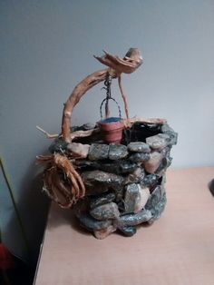 Fairy garden wishing well. Made from our local stones lol.