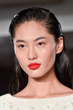 More wet-look, high-shine hair saturating the catwalks. The beauty brave will love the Zac Posen take on the trend with masculine slick-sides and finger-combed quiffs. The bold red lipstick came courtesy of MAC's Lipmix backstage. What a statement.