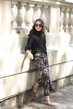 A cozy turtleneck and floral pants