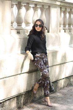 A cozy turtleneck and floral pants
