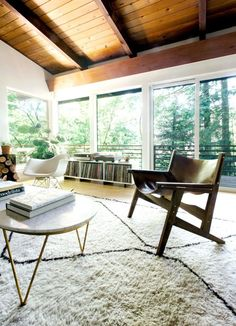 I have been a fan of Courtney Nye's designs since featuring some bits of projects hereand this kid's playroom. This mid-century home is a dream with tons of windows letting in all kinds of natural li