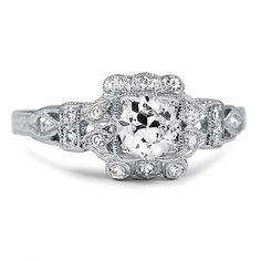 The Alexia Ring from Brilliant Earth This ultra-glamorous platinum Art Deco ring dazzles with the beauty of a circular brilliant cut diamond and sixteen glittering single cut diamonds, all accented by milgrain and delicate engraving (approx. 0.65 total carat weight).  Date: 1920's.