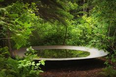 Situated in the middle of a densely forested section of the Reford property, Rotunda, by Spanish firm City Laboratory, is designed to evolve over time, showcasing the ephemeral qualities of the natural world. In the beginning, the large, irregular black-metal disk will function as an ordinary reflecting pool. Annual garden festival on the southern shore of the Saint Lawrence River in Quebec