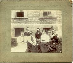 Photograph of several faculty members from the academic year 1897-1898. The only teacher that has positively been identified is E.L. Moseley, who is the man in the center.