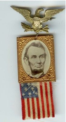 Abraham Lincoln Brass Shell, with Eagle, and American Flag. 1864 political pin.