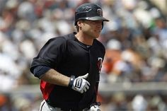 Minnesota Twins' Luke Hughes runs the bases after hitting a two-run home run against the Detroit Tigers in the second inning during a spring training baseball game in Lakeland, Fla., Wednesday, March 21, 2012.