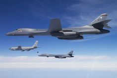 A U.S. Air Force B-1B Bones from the 337th Test and Evaluation Squadron (TES) stands by as another Bone connects with a U.S. Air Force KC-135 Stratotanker aerial refueling aircraft Feb. 23, 2012 for inflight refueling during a mission over the Gulf of Mexico near Eglin Air Force Base, FL.