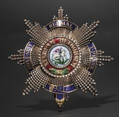 King George V of Hanover – a Breast Star to the Order of St. George with enamel band of the Order of the Garter, ca. 1860 - Lot detail | Hermann Historica