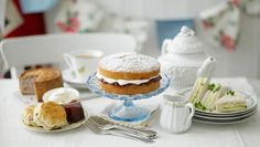 All of this. Is this a cream tea? I see scones, clotted cream, jam, finger sandwichs... and then maybe a sponge cake and a meat pie?