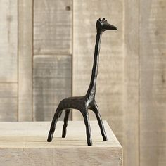 west elm -  i just love giraffes. not sure why...but there's a bookcase with this guy's name on it.