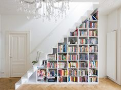 The modern stair case with all the books is nicely done along with the closet storage system