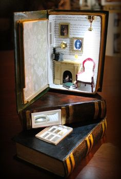 Book Boxes turned into miniature reading rooms that can be used as night lights for grown ups! www.suitcasedollhouse.com