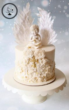 A christening cake made for my client Ann Rekha Roy's nephew. She wanted a pure white and gold themed cake with angels and a cross…. so i came up with this design with intricate details on the cake and sugar sculpted angel with waferpaper wings